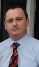 Mr. David Nolan, Príomhoide